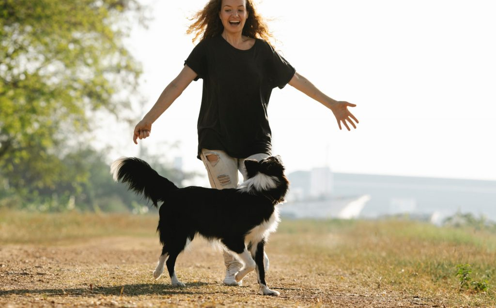 Girl Chasing a Dog